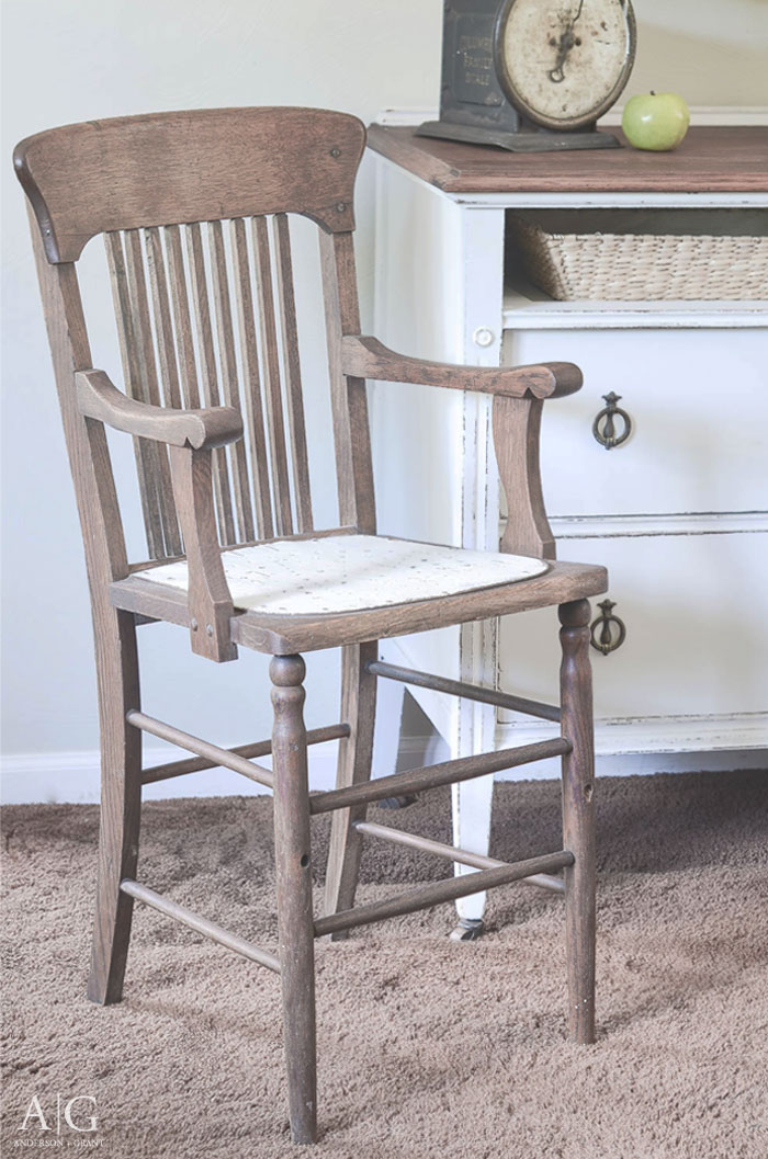 Antique wood high chair is charming in the dining room.  |  www.andersonandgrant.com