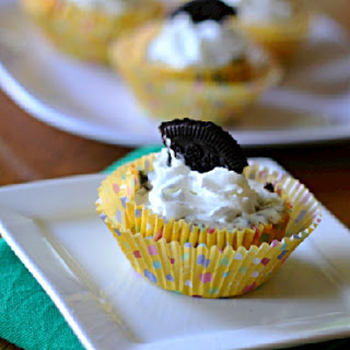 mini oreo cheesecake topped with whipped cream and part of an oreo