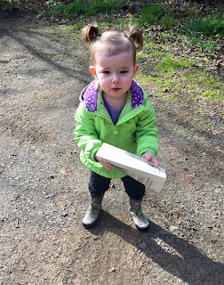 Montessori child holding a map for geography experience