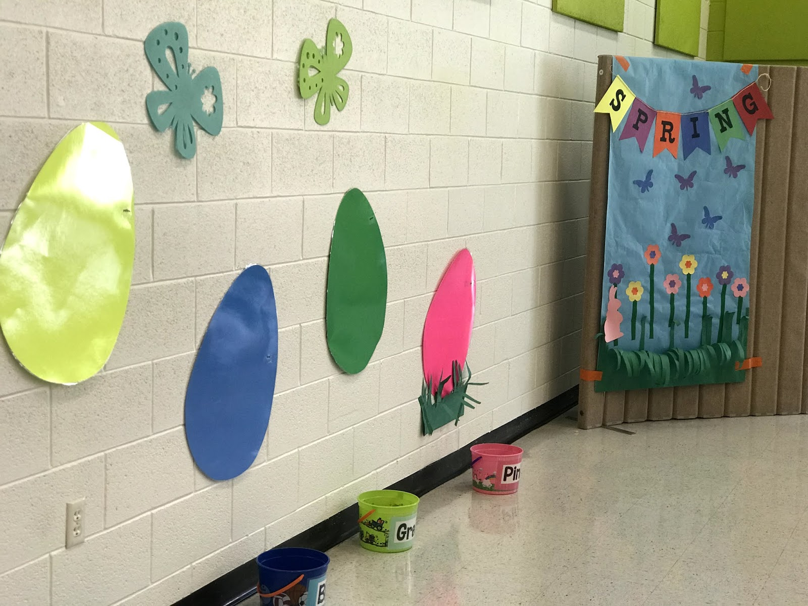 an image of the large colorful eggs taped to the wall