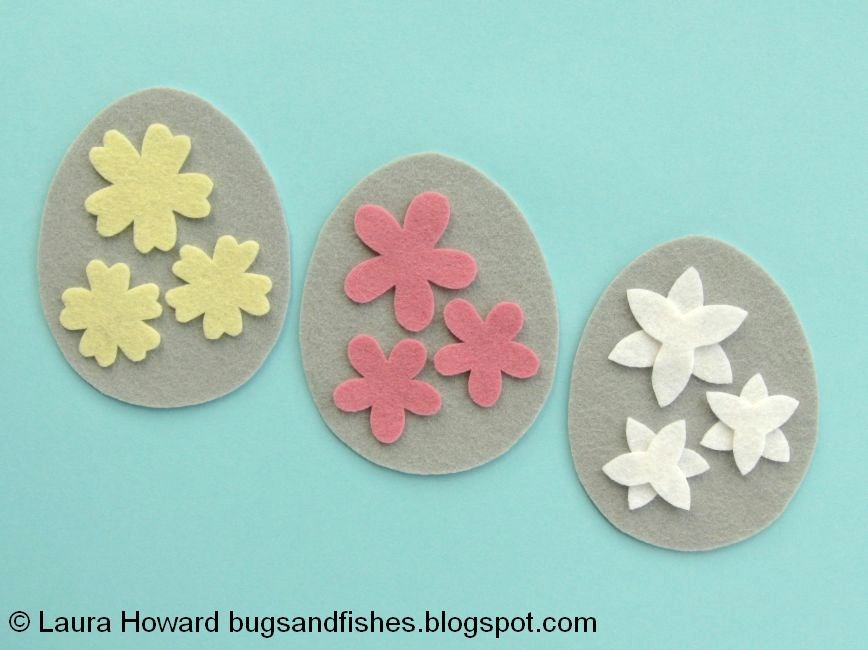 For each egg you want to make, cut out two egg shapes from grey ...