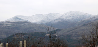 Snow on the peaks across the valley
