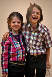 Portrait of a brother and sister child siblings in plaid professionally photographed by Cramer Imaging in Pocatello, Bannock, Idaho