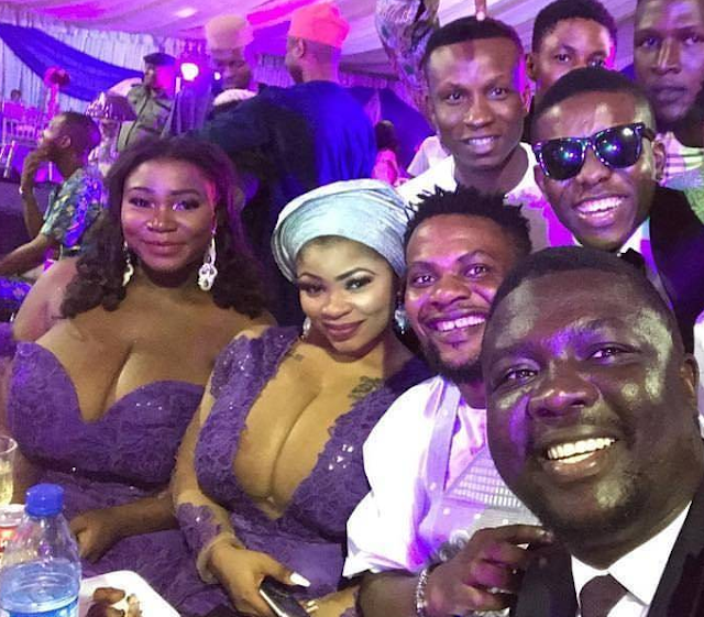 Seyilaw shares a photo with the busty ladies at Oritsefemi