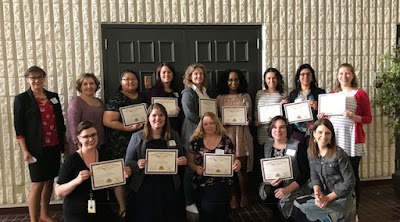 Eleven of the 20 graduates of the 2018 Financial Educator Certificate Program posed for a photo recently with FD staff Karen Shirer, Lori Hendrickson, and Mary Jo Katras. Karen and Lori are in the upper left; Mary Jo is in the lower right.