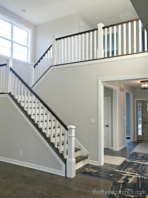 wood stairs with white spindles