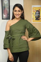 Pragya Jaiswal in a single Sleeves Off Shoulder Green Top Black Leggings promoting JJN Movie at Radio City 10.08.2017 090.JPG