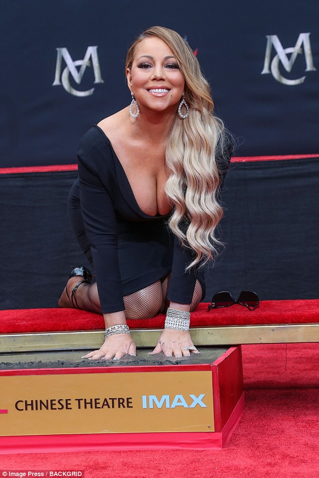Mariah Carey almost spills out of her revealing LBD