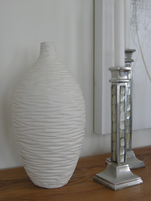 white textured vase, silver candlesticks, mother of pearl