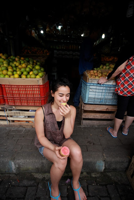 young woman eating guava
