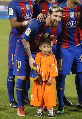 an Afghan boy who became an online hit after a photo of him wearing a Lionel Messi jersey