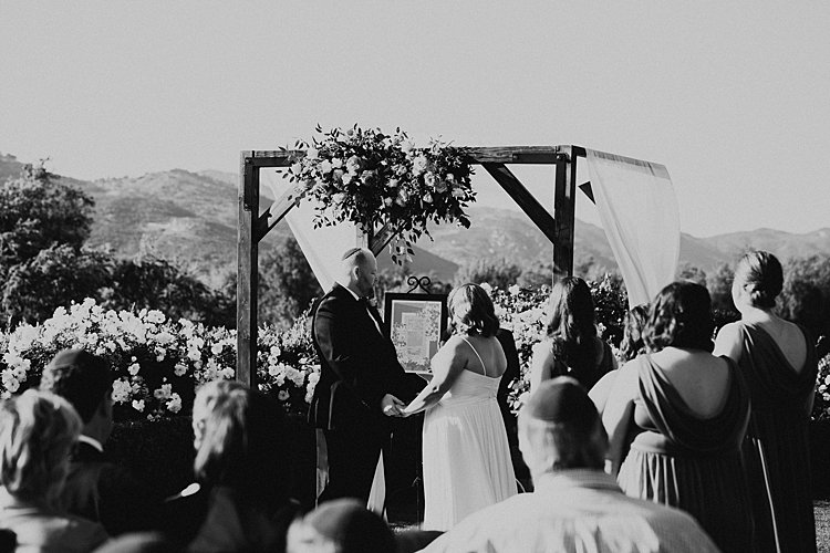 The handmade papercut ketubash is displayed under the chuppah in Courtney & Saul's elegant Jewish wedding. Photo by Vivienne Tyler Photography.