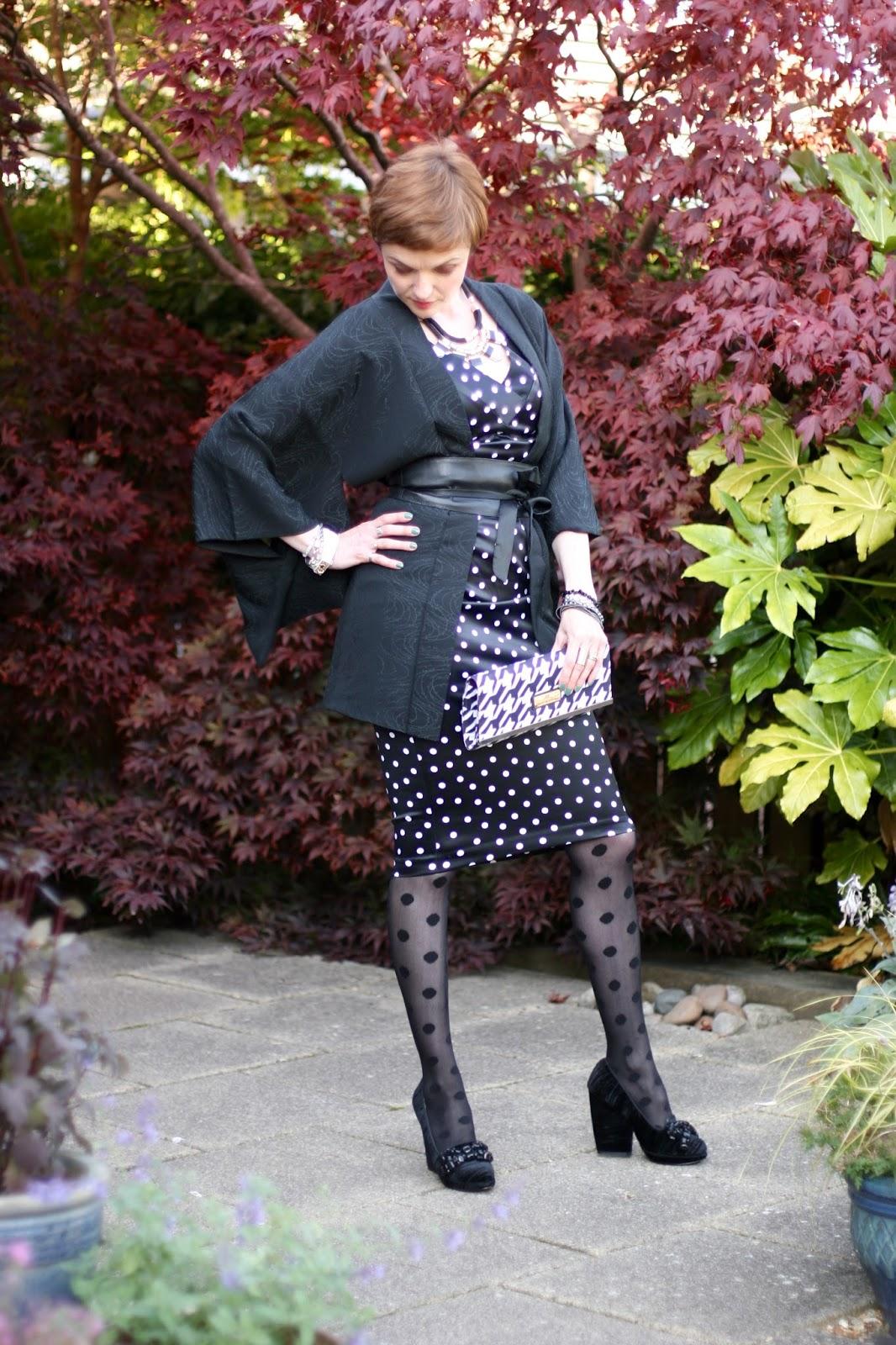 Spotty dress and spotty tights.