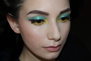 bright colorful eyeshadow makeup winged eyeliner