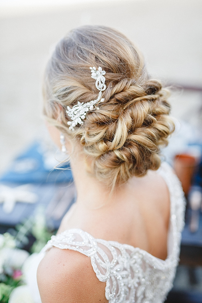 Elegant Bridal Updo with jewel-encrusted hairpiece | Photo: Damaris Mia Photography