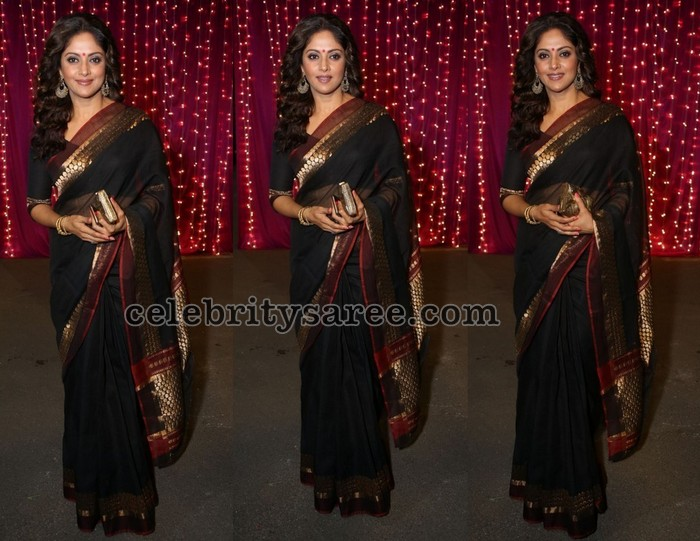 766c93c94abe0f South Indian actress Nadhiya wearing black silk saree with red and brocade  work border, shimmer pallu. Paired with elbow length sleeves blouse with  round ...