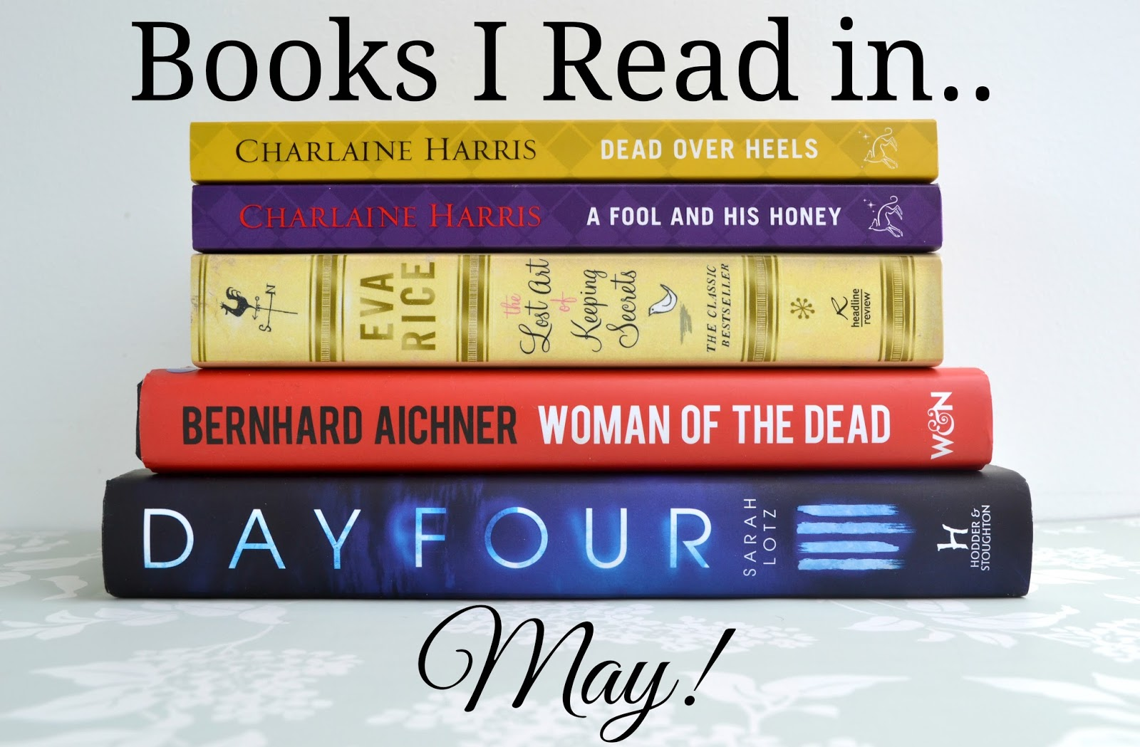 Pile of books including Dead over Heels and A Fool and his Honey by Charlaine Harris, The Lost Art of keeping Secrets by Eva Rice, Woman of the Dead by Bernhard Aichner and Day Four by Sarah Lotz