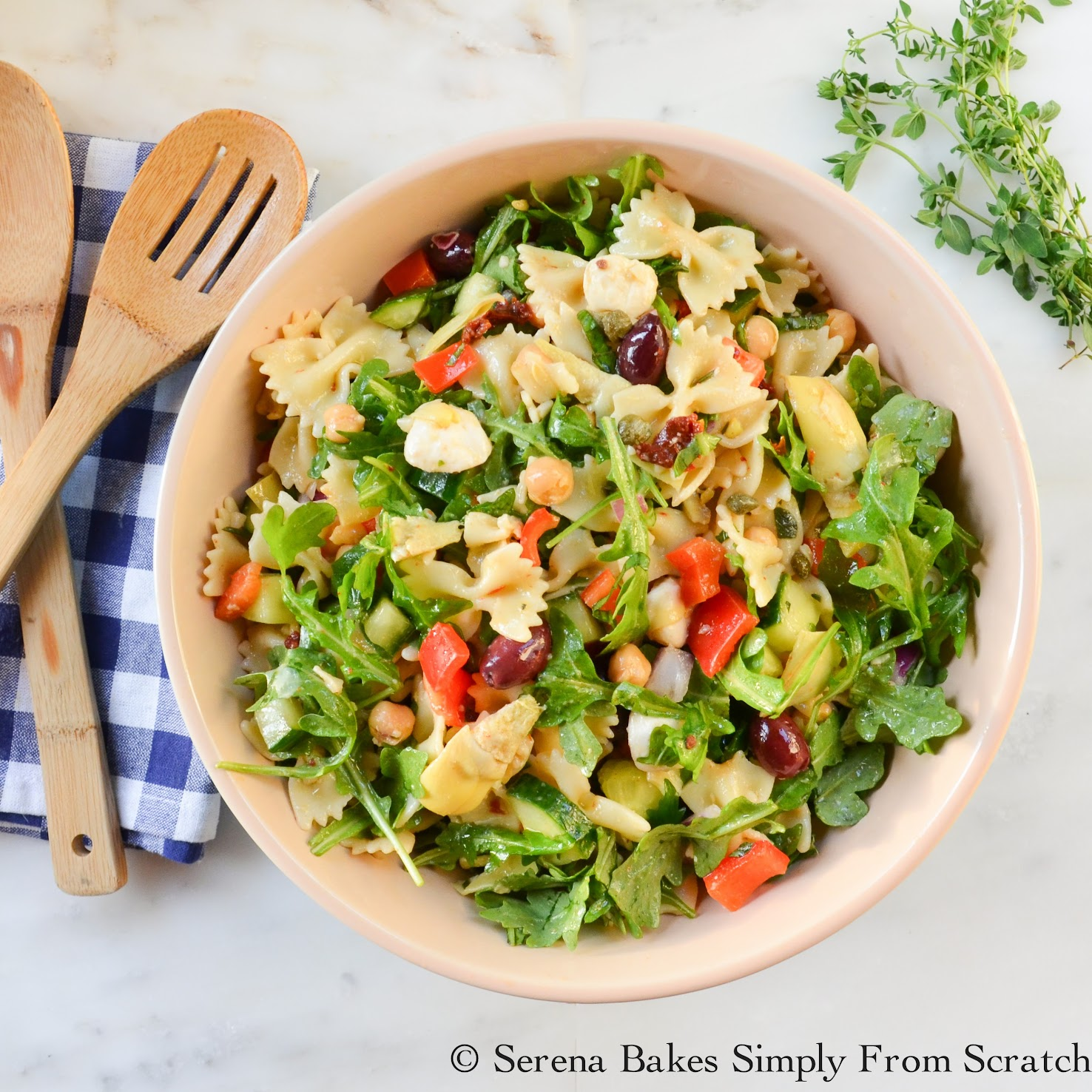 Mediterranean Pasta Salad is filled with artichoke hearts, capers, and sundries tomatoes! A must make!