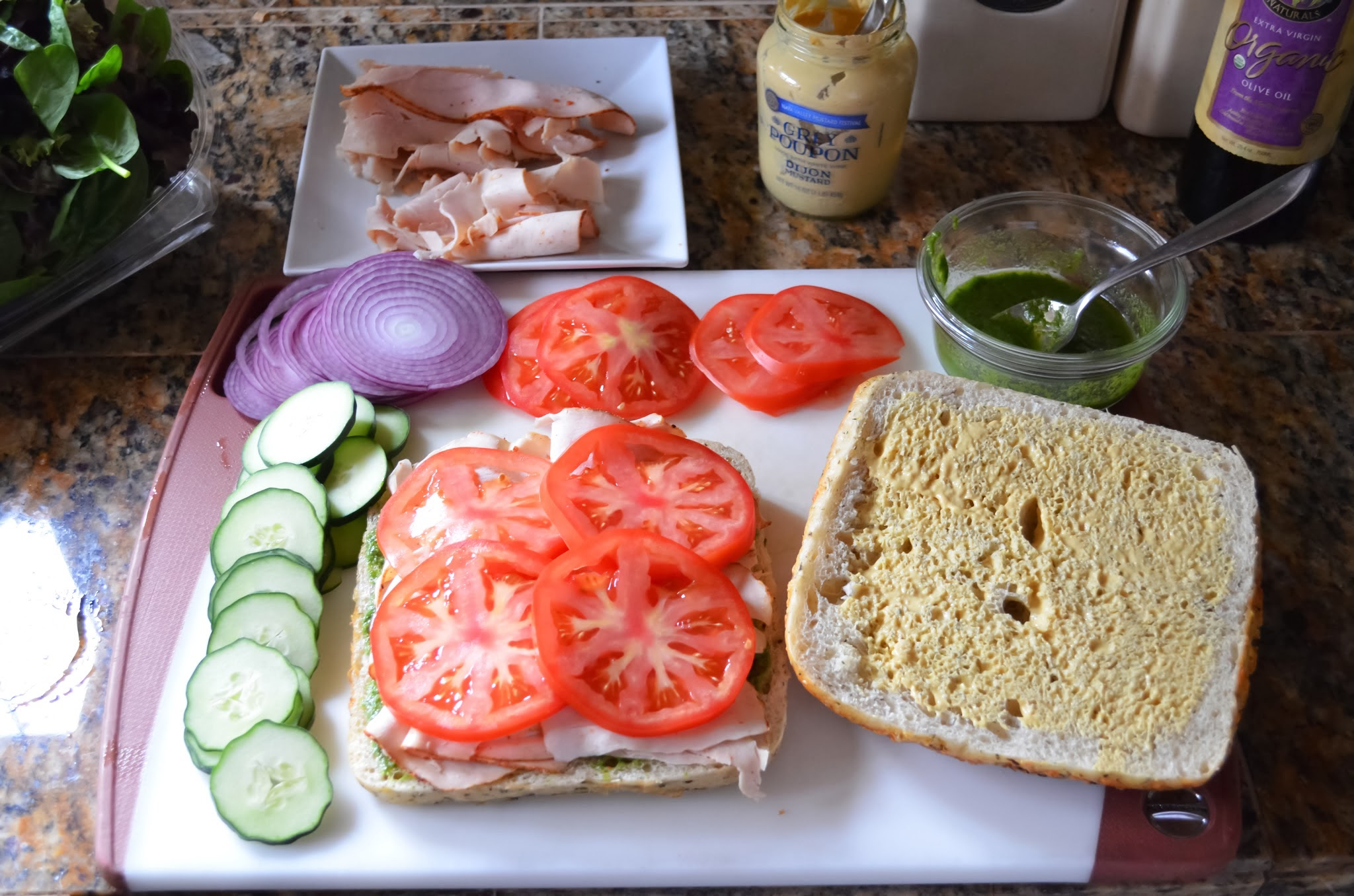 Turkey covered with tomatoes on focaccia bread.
