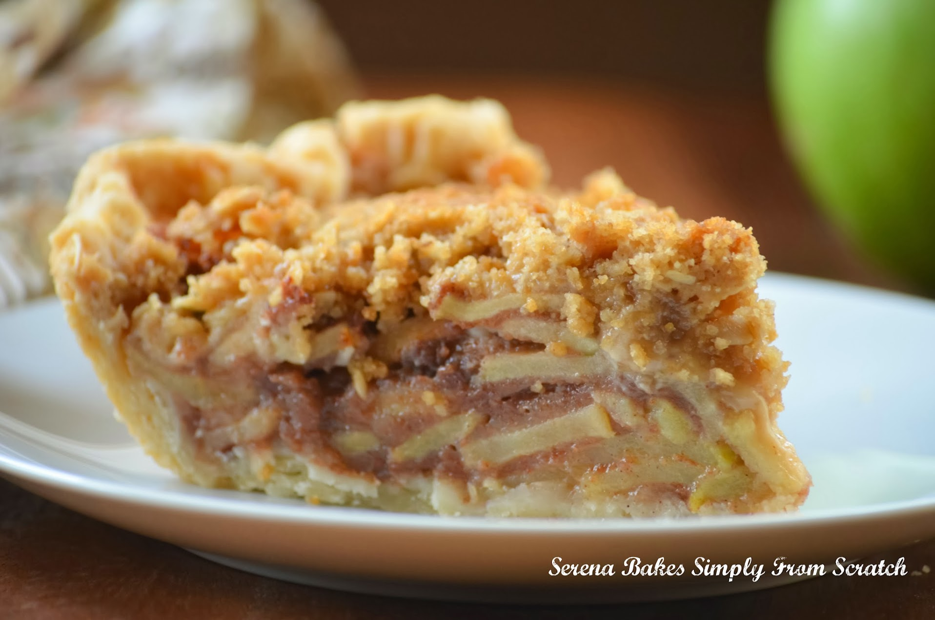 Caramely Apple Pie With Crunch Topping brings all the favorite flavors of fall into one perfect slice of pie. serenabakessimplyfromscratch.com