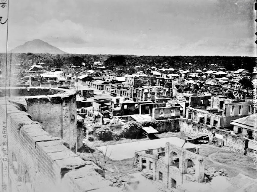 Original caption:  View of the municipality of Lipa, Batangas, showing destruction; looking west from the Lipa Cathedral.  Photo taken by Pfc. Robert Wilson on 8 October 1945.