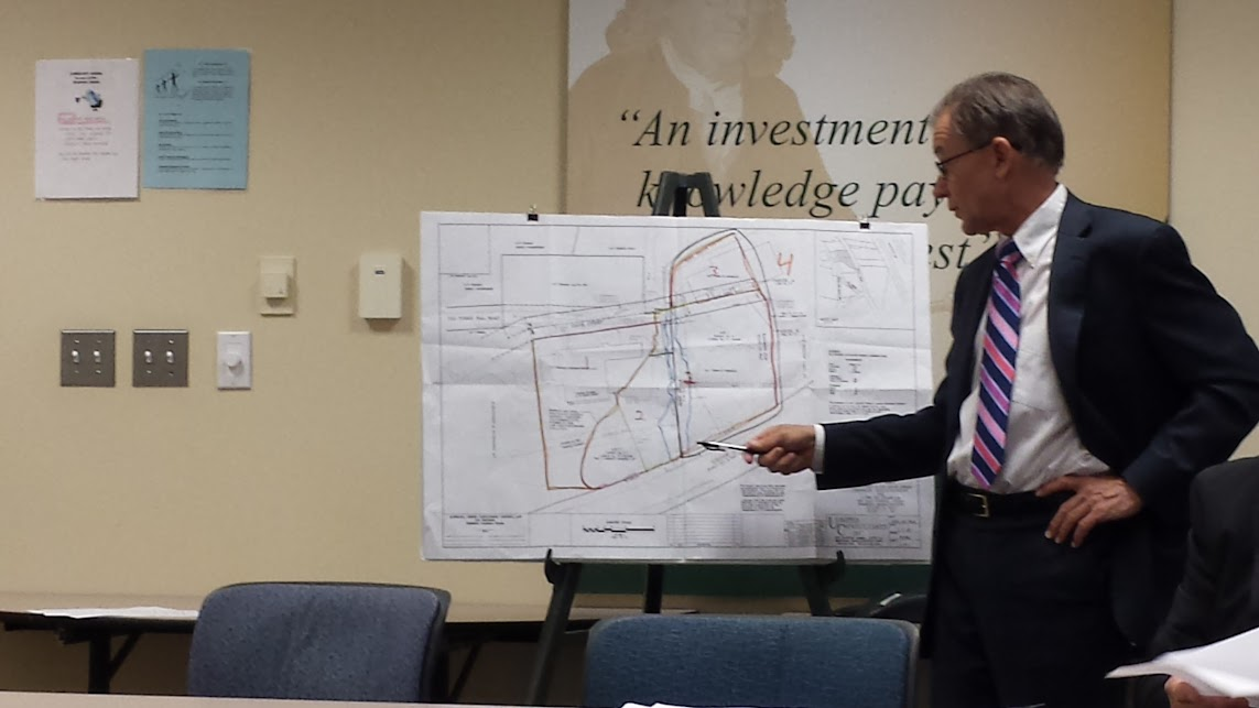 Town Administrator Jeff Nutting uses the Nu-Style map to talk about the plans