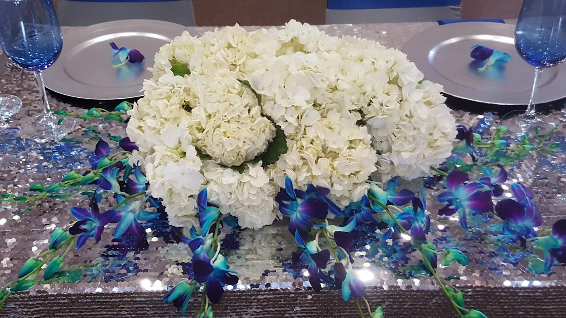 Silver sweetheart table with hydrangeas and orchids