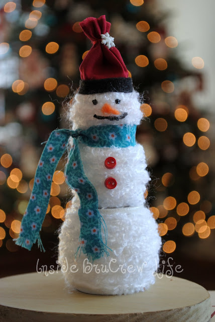 Use wooden spools to create this easy Yarn Snowman