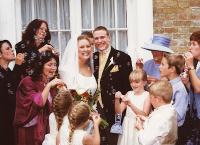 PippaD and Flyfour aka Daddy on their wedding day surrounded by friends and family