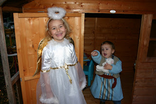 Top Ender dressed as an Angel with Baby Boy dressed as a shepherd showing her the way out
