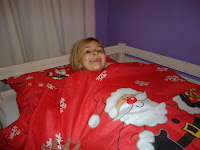 Top Ender in Bed with Christmas Bed Linen