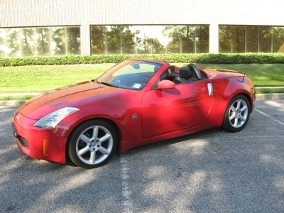 Pumpkin Fine Cars Exotics Car Of The Day A 2004 Nissan 350z Touring 2 Dr Roadster This Red Hot Pre Owned Convertible Edition Will Keep Heads