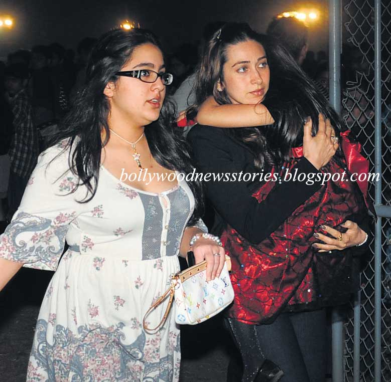 ... arms, walks to the Midnight Mass with Saif Ali Khan's daughter, Sarah