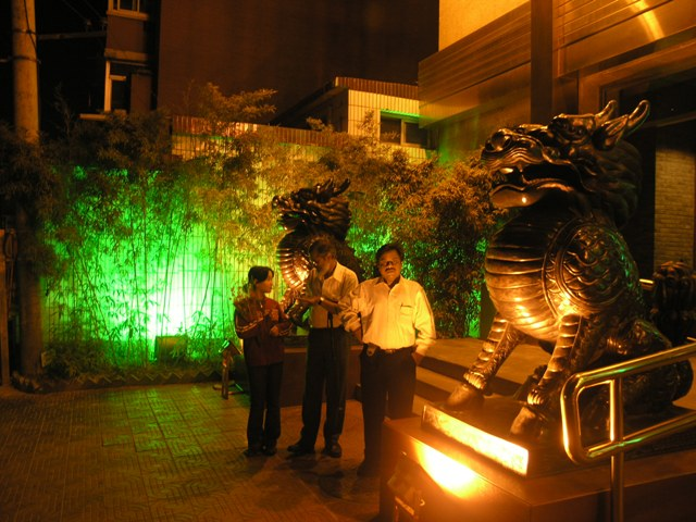Outside the restaurant . . . in the eerie glow of the lights and the dragons
