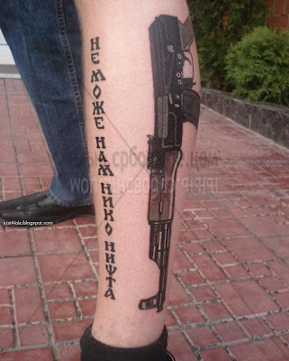ak47 on leg tattoo
