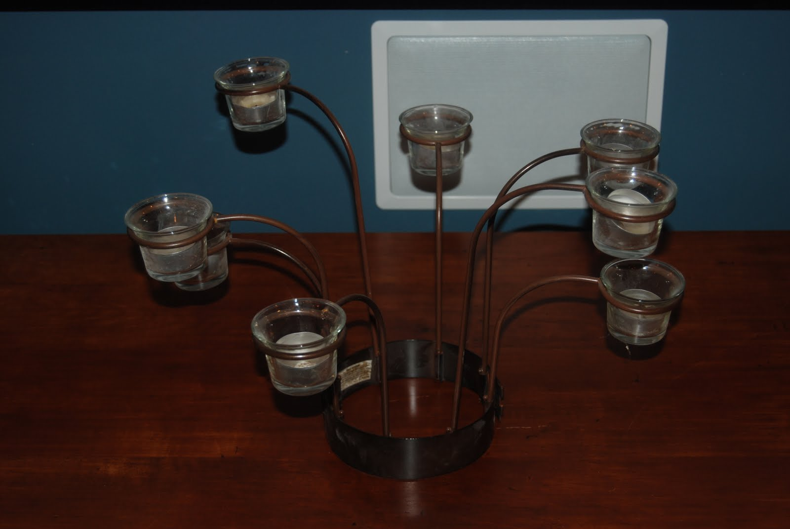 """The Delp's """"Yard sale"""": Votive candle holder for around an"""