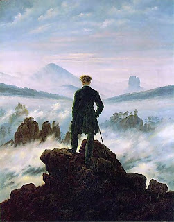 Wanderer at the top of a mountain