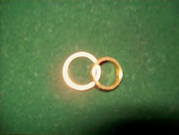 Two glowing golden rings symbolizing lasting marriage