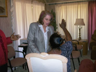 preaching the Word of God and ministering laying on of hands for healing and deliverance breaking bondages of addiction