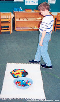 NAMC montessori activities developing presenting around student interests walking around the mat
