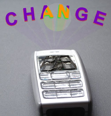 A mobile phone projecting the word CHANGE
