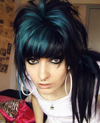 black and electric blue hairstyles. Big dark blue and black emo hairstyle. With great eyeliner and piercings to
