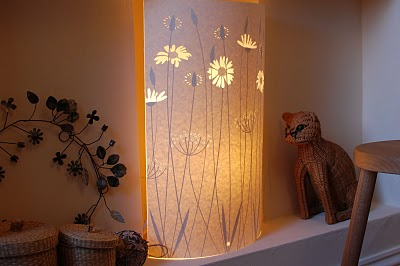 paper light with paper cut daisies design