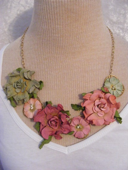 pink and green paper flowers necklace on golden chain