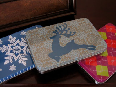three patterned metal tins that are rectangular and shallow