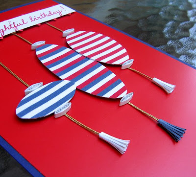 handmade birthday card with striped paper lanterns and paper tassels