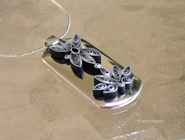 silver and black quilled necklace pendant