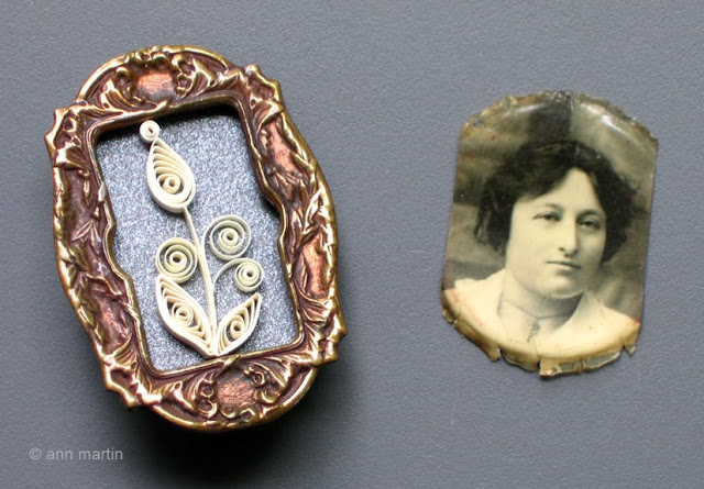 1920s shadow box portrait brooch containing quilled flower alongside vintage portrait of young woman