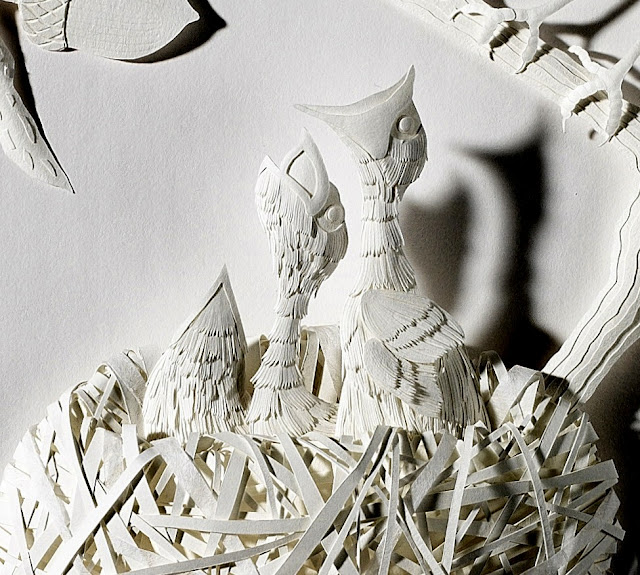 white paper sculpture nested robins feeding