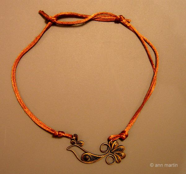 quilled golden bird pendant on bronze silk cording